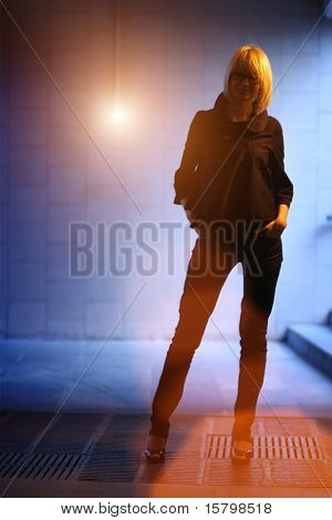 Female model silhouette in underground tunnel