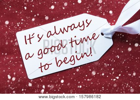 One White Label On A Red Textured Background. Tag With Ribbon And Snowflakes. English Quote It Is Always A Good Time To Begin