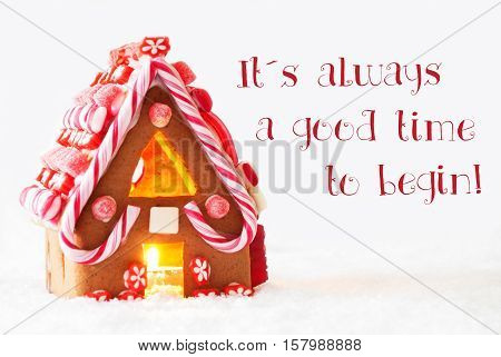 Gingerbread House In Snowy Scenery As Christmas Decoration With White Background. Candlelight For Romantic Atmosphere. English Quote It Is Always A Good Time To Begin