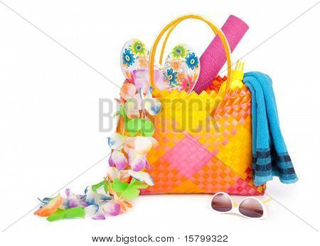 beach bag with towel sunglasses and flip-flops .isolated on white