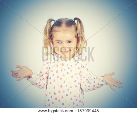Little girl arms out surprise . Emotions.