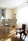 Interior house, nice livingroom piano and chair poster
