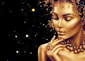 Gold Woman skin. Beauty fashion model girl with Golden make up, hair and jewellery on black backgrou poster