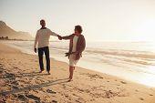 Playful Senior Couple On The Beach poster