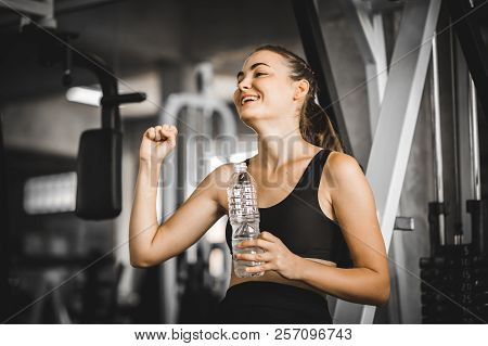 poster of Fit Young Woman Caucasian Sitting And Resting After Workout Or Exercise In Fitness Gym. Woman At Gym