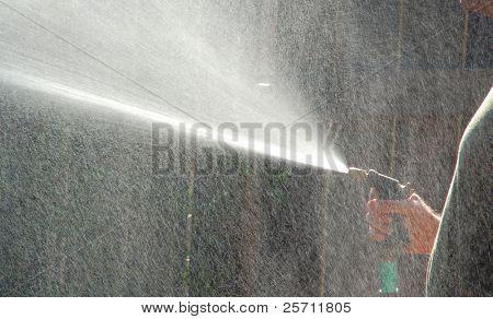 Man Watering Lawn