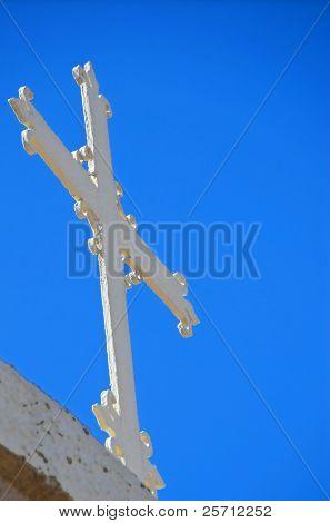 Cross Against Blue Sky