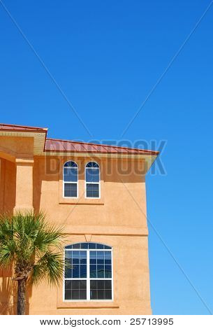 Stucco Coastal Home with Tile Roof