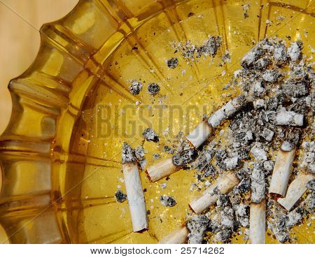 Vintage Ashtray with Filterless Cigarette Butts and Ashes