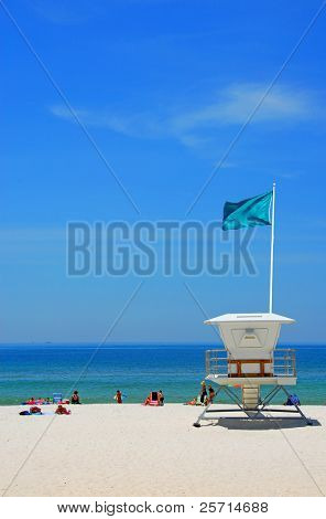 Lifeguard Station on Beach with Green Flag Waving