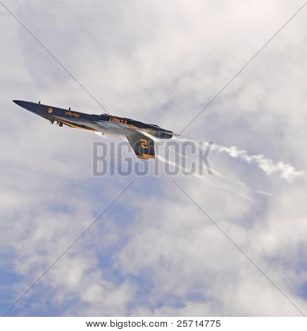 Inverted Navy Blue Angel F-18 with Vapor Trail and Wingtip Vortices