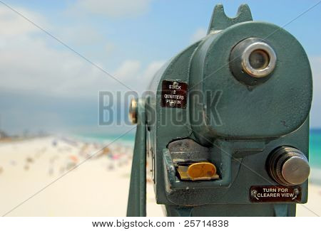 Telescope Viewfinder Overlooking Crowded Beach