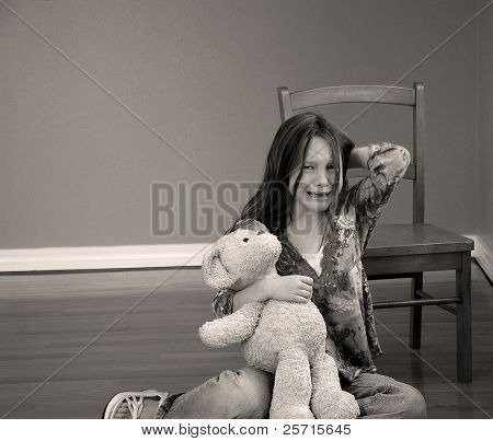 Girl Crying on Floor with Bear