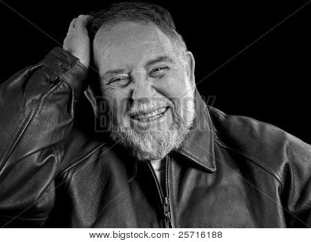Older Caucasian Male Laughing with Hand on Head