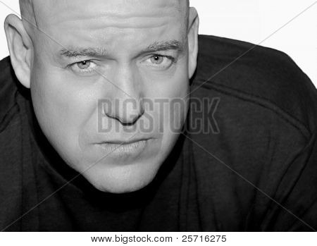 Handsome and Rugged Middle Aged Man with Serious Expression