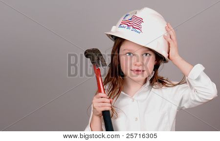 Young Girl in Construction Hard Hat Holding Hammer