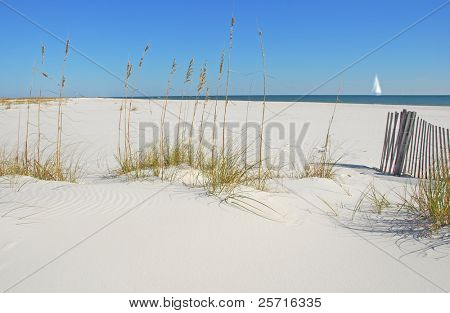 Beautiful Pristine Sand Dunes with Sailboat in Distance