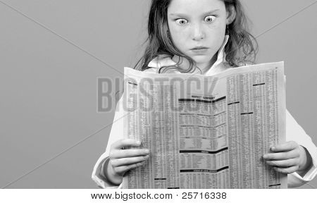 Young Girl in Shock and Awe Over Financial Page in Newspaper