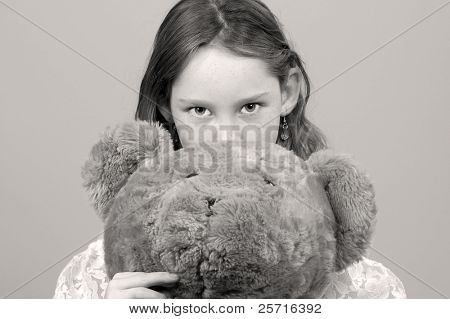 Young Girl Looking Up Hiding Behind Huge Stuffed Bear