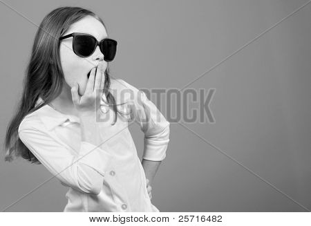 Young Girl in Oversized Sunglasses Looking Shocked or Surprised