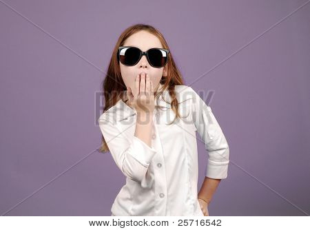 Young Girl in Oversized Sunglasses Looking Surprised