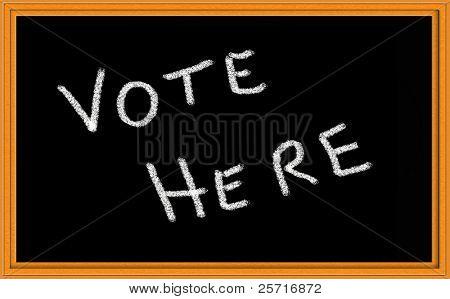 vote here written on chalkboard