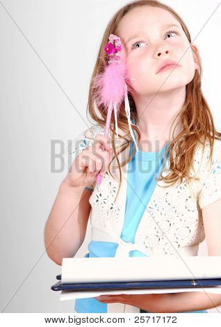 Young Girl Concentrating While Writing