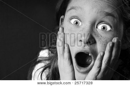 Young Toothless Girl Looking Shocked or Frightened