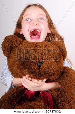 Girl Excitedly Hugging her Bear
