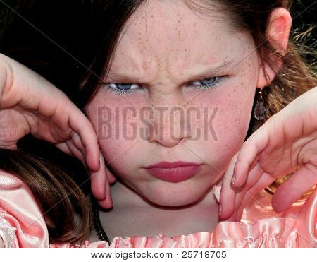Young freckle faced girl looking unhappy or upset