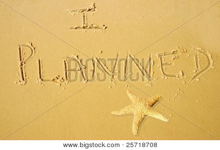 I PLANNED written in beach sand next to starfish