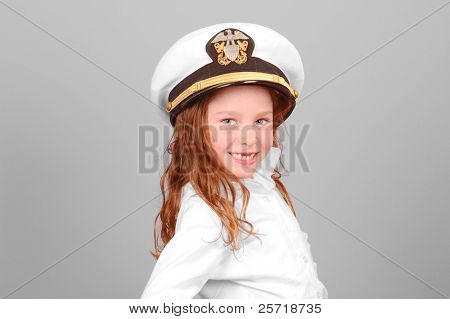 Young girl wearing officer sailor's cap