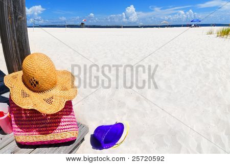 Beach bag and buckets on boardwalk by beautiful seashore