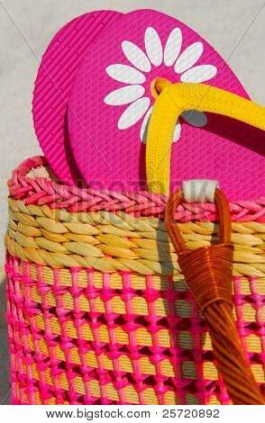 Pink flip flops in pretty beach bag