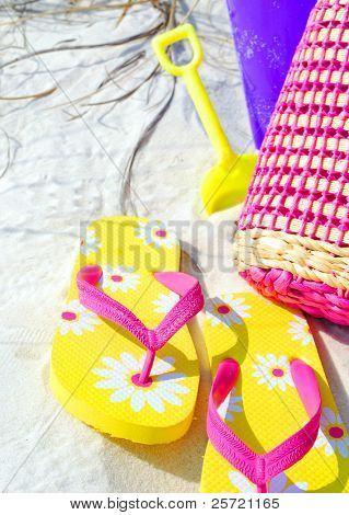 Yellow flip flop sandals on beach