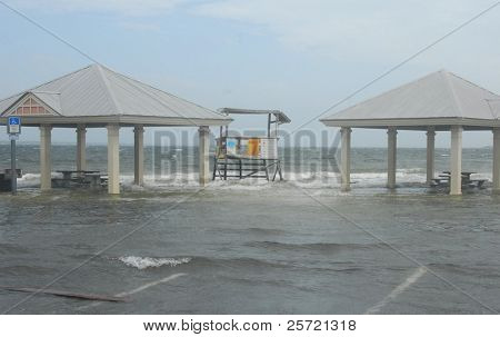 PENSACOLA - SEPTEMBER 11:  Waves caused by Hurricane Ike move over a life guard station along the Pensacola Bay area September 11, 2008 in Pensacola, FL. Ike is currently at Category Two.