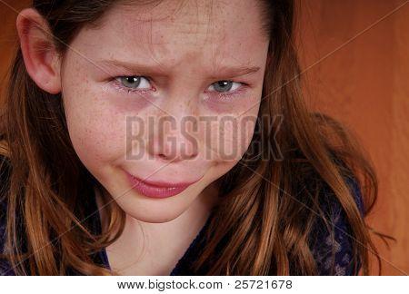Young girl crying and upset