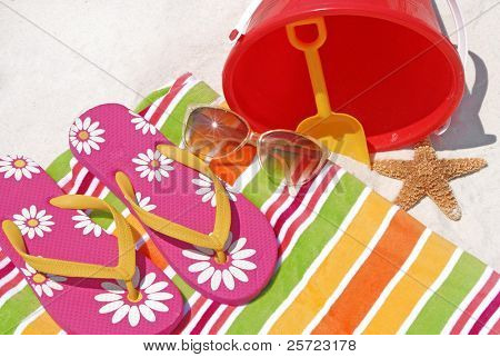 Pretty beach supplies on white sand