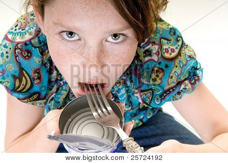 young girl eating food straight from can