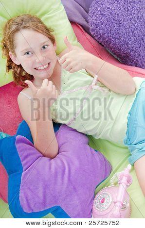 Happy girl in relaxing in room