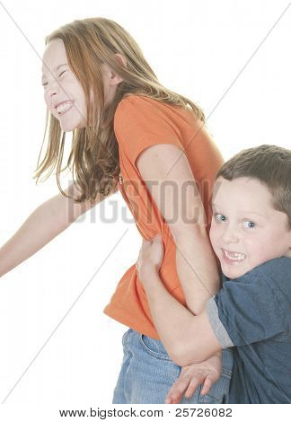 Young girl and boy playing tickle game