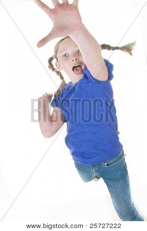 young girl with braids jumping
