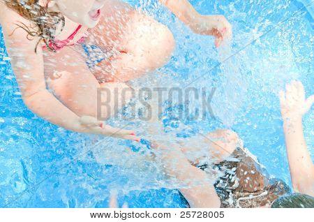 Young kids having fun in pool