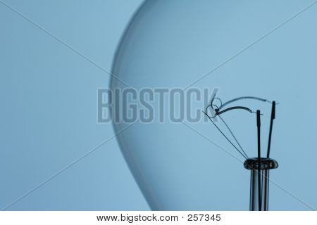 Light Bulb Filament On Blue Background