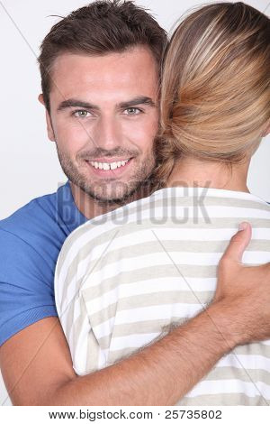 30 years old man hugging a woman, her face is not visible on the photo