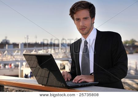 Student using laptop outdoors