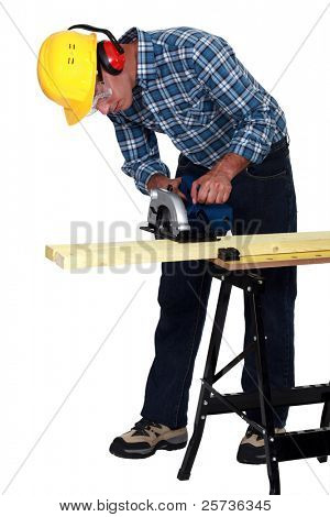 craftsman cutting a board