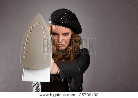 Attractive female model holding iron out in front