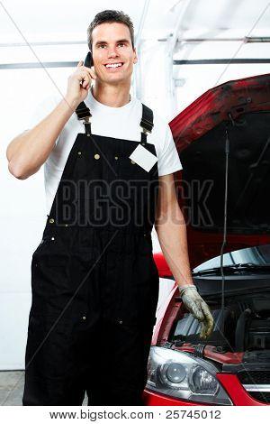 Professional auto mechanic in auto repair shop. Garage.