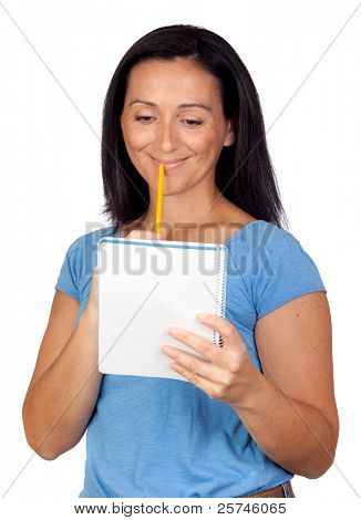 Brunette woman lookin a notebook isolated on a over white background